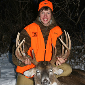 This hunter got it right, besides...with a deer like that how could you not show a big ol' smile.